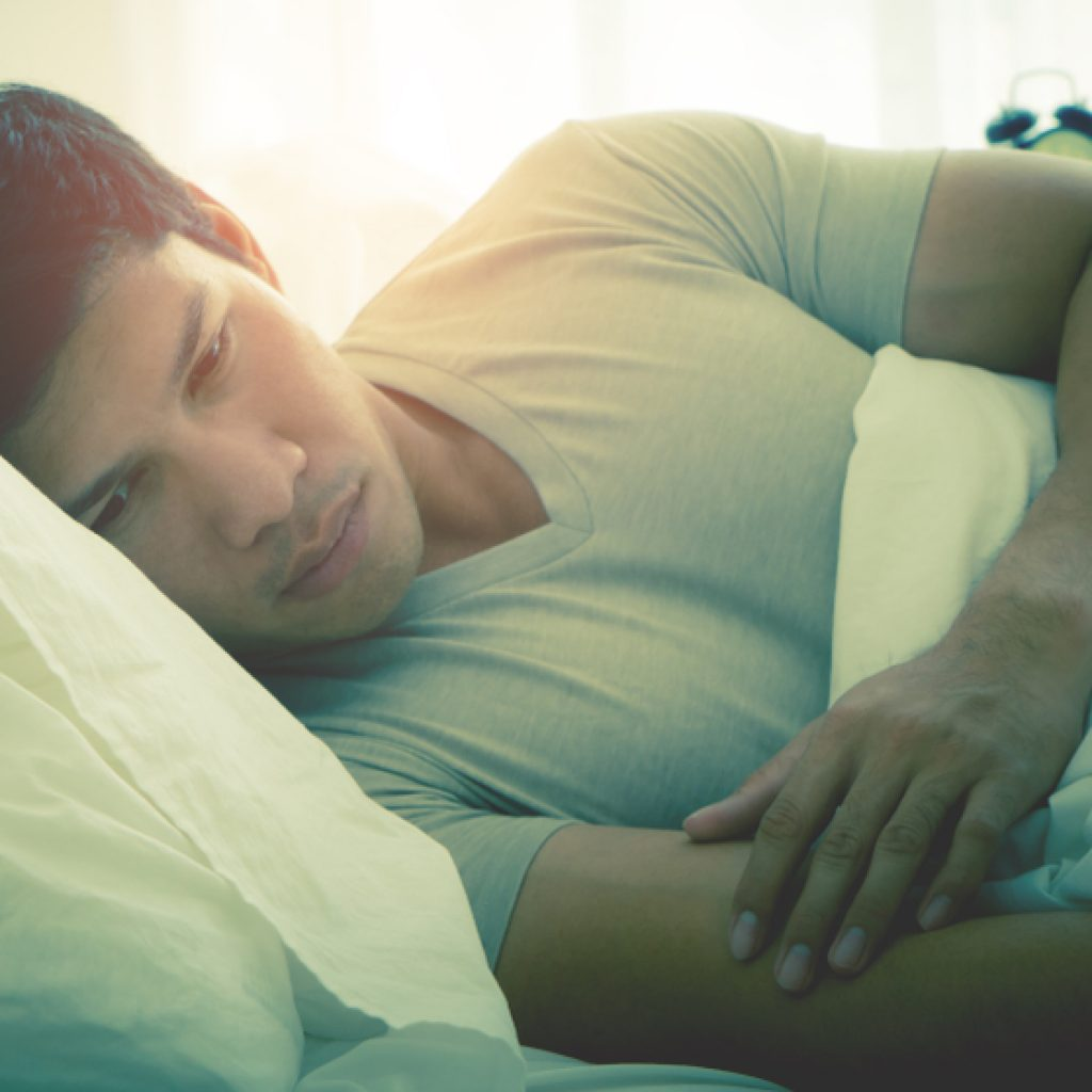 Man in bed with trauma